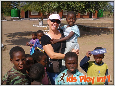 Tracy Evans helping kids in Rwanda