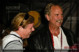 Olympians Katherine Starr (L) and John Naber attend a