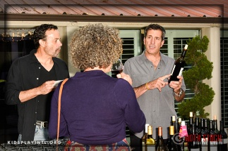 Uncorked's Jeff Bonafede (R) discusses wine with a guest at the 6th Annual Cocktails to Benefit Kids Play International