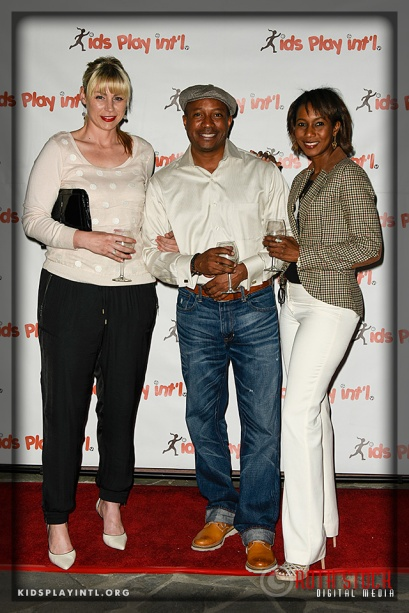 (L-R) Professional soccer player Anne Poulin with Mark Moore and Sonianne Brathwaite